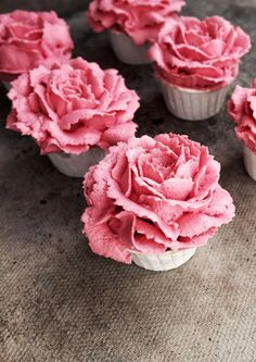 raspberry and white chocolate flower cupcakes.
