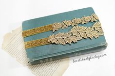 Beautiful and lovely garter set made of metallic gold leaf lace and flower lace with 5/8 gold glitter elastic. Unique design and warm looking. Leaf