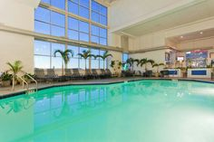 The indoor pool and surrounded by palms in a four story atrium in the Holiday Inn Hotel and Suites here in Ocean City, Maryland.