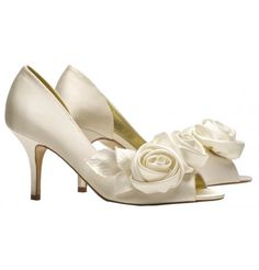 Annette by Freya Rose. Gorgeous mid high peep toe shoe with cut-out on inner side of shoe. Ivory satin covered heel. Ivory Duchesses silk satin upper and beautiful classic rose detail, soft platinum gold kid leather lining and leather sole. Extra padding ensures comfort.Detail on the shoe comes as a detachable shoe clip, however if you prefer the detail to be permanently fixed we will do this free of charge, this can be done within 1 year of your purchase.