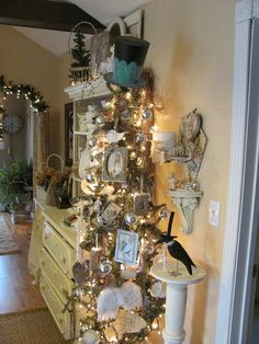 shabby chic Christmas tree with vintage inspired decorations and tophat topper