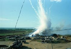 This general view shows a direct hit with North Vietnam 122 mm shell explosion in a U.S. ammunition bunker of 175 mm cannon emplacements at Gio Linh, next to demilitarization zone between north and south Vietnam, Sept. 1967, during the Vietnam War. (AP Photo)