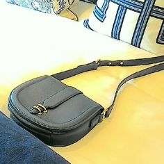 "FLASH SALE! NWOT Banana Republic Purse Price firm. Banana Republic navy blue leather crossbody purse. NWOT. Cutest purse ever! Very ivy league and perfect for a job interview. Beautiful shade of navy.  Real Italian pebble grain leather. Tan fabric inside with two open pockets and one zippered pocket. Gold hardware. Three holes for strap adjustment. 8"" in height. 8"" in width.  Pristine condition. Never used. This purse looks expensive! It is a classic addition to your wardrobe that will…"