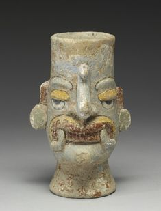 Mixtec ceramic flask, 1200–1500, portraying the head of Tlaloc (with symbolic barbels). (Walters Museum)