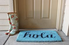Fix up a battered old doormat with nothing more than a roll of masking tape and a can of spray paint with these simple masking tape letters doormat redo!