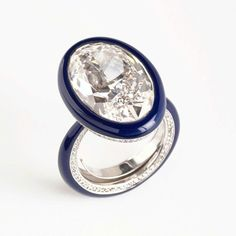 A 10.10 carat diamond is surrounded by a band of glossy blue ceramic in this G ring by Glenn Spiro