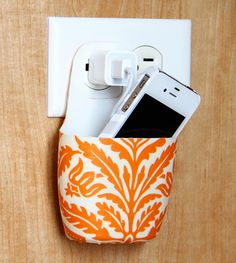 Handy and stylish DIY project for a holder for your cell phone while it charges.