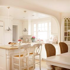 Would like to do this between kitchen and living area in our open plan.  Add Architectural Details.  Bring your basic builder's kitchen to life. Frame windows with wide molding, install cornices on top of cabinets, or add bun feet or carved legs to cabinets for furniture-style accents