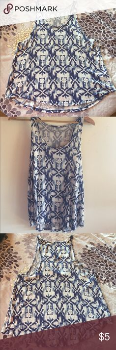 Mudd ~ Blue & White Aztec tank Mudd brand tank. Very light weight. Perfect for summer! Aztec design in colors of blue, white and a little light blue in the mix. The underarms hang low. Meant to be worn with a bandeau or layered with another tank. The size says Large but I think it fits more like a medium. Mudd Tops Tank Tops
