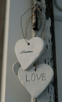 Plaster of Paris / cement hearts with wire- so shabby chic!