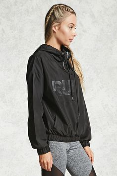 "A woven windbreaker featuring a tonal ""Run It"" graphic on the front, drawstring hood, a zippered front, two front welt pockets, and an elasticized hem and long sleeves."