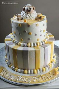 baby shower cake- Roxanne- do this one in blues and green, and yellow, and put babys name on board