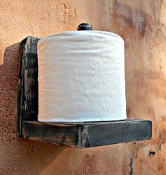 A Rustic Wood Wall Toilet Paper Holder. The item you see in these photos is the exact item you will receive when ordered. Rustic and simple