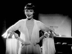 Animated gif of Louise Brooks smiling and laughing - click through to view the amazing sleeves on this gown. pandora's box, g.w. pabst, 1929