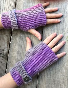 Free Knitting Pattern for Easy Garter Stitch Fingerless Mitts With Strap - Pluviôse is an easy fingerless mittpatternknit flat in garter stitch on straight needles. The simple pattern is dressed up with a garter stitch tab and embellished with your prettiest buttons. Designed by Solenn Couix-Loarer who says the pattern is great for beginners. Great for multi-color yarn. Rated very easy by Ravelrers. Available in English and French.Pictured projectby Mamaloftin