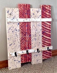 Give your room an artistic look by placing classy and stylish reclaimed wood pallet coat and hat rack You can paint it according to your taste and desire. Reused wood pallets patriotic coat and hat hanger add beauty as well as comfort in your life. Its unique and artistic design proves to be very captivating and attractive. The upper hanging space is for coats and the lower one is for the hats.