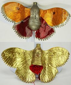 Antique Dresden luna moth candy container Christmas ornament. Gold and silver leaf with orange and red mica overlays. The underside contains a red silk pouch for candy or small present. 5.5 x 3 x 1 inch. [missing antennae.] | SOLD $486 eBay Nov. 24, 2015