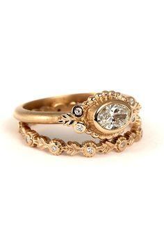 "Brides.com: . ""Wood Nymph"" oval ring (shown with ""Wood Nymph"" leaf eternity band), 18K rose gold, oval white diamond, price upon request, Megan Thorne"