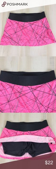 "Nike-Dri FIT Run Skort Skirt 534961 Athletic Sz. S Nike Dri-Fit Women's Running Athletic Skort/Skirt Style Number:  534961-658 Design:  Lineograph Size: Small Color:  Pink, Black Fabric:  Skirt: 100% Polyester   Shorts:  92% Polyester  8% Spandex Pre-owned, good condition,  Product details:  • Great for running, tennis, & more • Wide waist band  • Side vents for ease of movement • Built in short • Nike logo on side Measurements:   Waist: 13 1/2""  (laying flat, side to side) Short Inseam:  3""…"