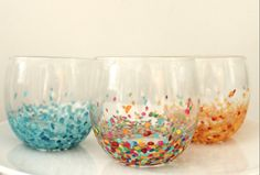 Use acrylic paint (but seal it afterwards) to recreate these confetti-dipped glasses.Get the tutoria... - Radical Possibility
