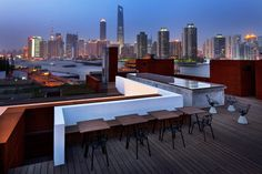 Building upwards has the obvious advantage of offering improved views; in this case, of the Pudong skyline from the new roof terrace; architecture: NHDRO, photo: Derryck Menere