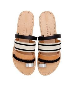 Meet the perfect pair of sandals: Isapera's 'Gerbera' slides are handcrafted in Greece with a soft single toe strap and leather and woven fabric arch straps.
