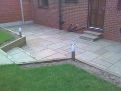 Indian Stone Patio - Moses Gate, Bolton. Autumn natural stone flags. New sleeper retaining wall. Stone drives.