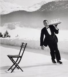 Alfred Eisenstaedt in Switzerland. ❄️ #ICPCollections Headwaiter Renée Breguet of Grand Hotel St. Moritz serving cocktails on ice rink, 1932