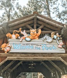 the adventures of winnie the pooh sign