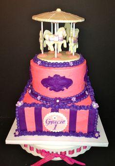 CakesbyKirsten.  #carousel #pinks, purple. #buttercream