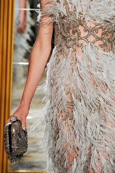 All the glitz and glamour of the roaring '20s in one fabulous, feathered fringe dress. #Marchesa
