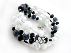 Formal Swirl bracelet $19.00 Ladies beaded Swarovski crystal bracelet Black crackled glass beads, white and black glass seed beads, white and black fire polished Czech glass beads, Swarovski crystal and Tibet silver are combined together for a stylish look. The bracelet is strung onto memory wire for strength, durability and drape.