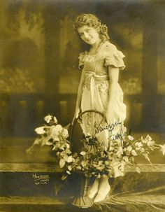 Mary Pickford with a basket of flowers, c. 1920