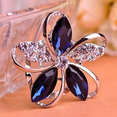 Blucome Bridal Jewelry Colares Blue Rhinestone Flower Brooches For Women Hats Bijoux Scarf Buckles Party Corsages Hijab Pins. Yesterday's price: US $6.63 (5.39 EUR). Today's price: US $4.84 (3.94 EUR). Discount: 27%.