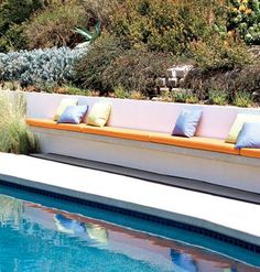 Built-in benches offer easy seating for this backyard pool. tied ...