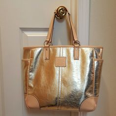 "Coach Gold Leather Tote Authentic. Used only a handful of times. Excellent condition. No wear on edges or bottom (see additional listing for photo.) Clean exterior and interior. Gold leather zipper pouch included. Zippered interior pocket with 2 fabric pockets made of tan lining fabric.   1 spot on front & 1 spot on back where there are small scuffs. See additional listing.   No trades. Thank you.   12.5 x 13.5 x 5; leather shoulder strap drop 7"" Coach Bags Totes"