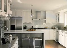 This sleek gray and white kitchen was completed by Zephyr. #luxeSanFran