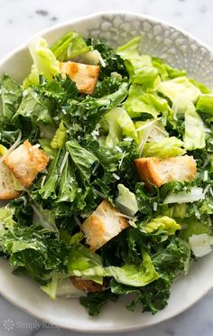 Kale Caesar Salad with Creamy Parmesan Dressing ~ Easy kale and romaine Caesar salad with a creamy Parmesan dressing without egg. Great for a potluck! ~ SimplyRecipes.com