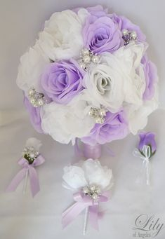 Model: WTLV02  This wedding flower package is made with lavender Peony, white open Roses, decorated with pearl jewels.    17 Pieces package
