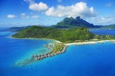 Bora Bora, French Polynesia. This picturesque Polynesian island is the definition of a tropical island paradise. This breathtaking island is known for its magnificent turquoise waters, clear white sand beaches and lush greenery. As beautiful as the photos are, this favourite honeymoon destination is even more breathtaking in person.