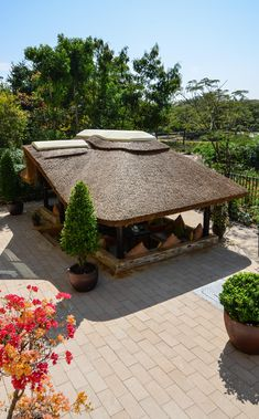The addition of a thatched roof gazebo to your property is a great way to extend your outdoor living space and an excellent way to add value to your property whilst improving your quality of life. Outdoor Gazebos, Backyard Gazebo, Outdoor Areas, Outdoor Lounge, Outdoor Living, Outdoor Structures, Bamboo House Design, Bungalow House Design, Modern Tropical House