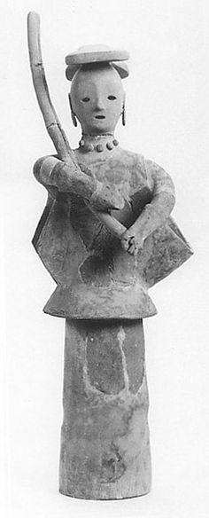 The Kofun period (AD.250?AD.592) art,Haniwa terracotta clay figure.   Medium. She have arrow.  Shiga Japan.