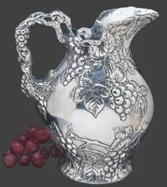 Arthur Court Grape Collection Pitcher - Milk and iced water just seem colder in aluminum. This heirloom of tomorrow is hand crafted from the time-honoured maker of elegant servingware. Sand casted in a pewter-like alloy that never requires polishing, this seemingly antique French pattern conjures thoughts of a Bordeaux vineyard in 1890.