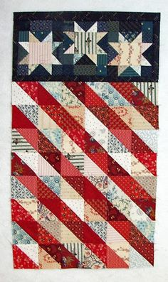 Fourth of July wall hanging at Quilt Crossing: July 2013 I may use this as a big block for part of a Fantastic Patriotic Quilt. Blue Quilts, Star Quilts, Scrappy Quilts, Mini Quilts, Quilt Blocks, Star Blocks, Hanging Quilts, Quilted Wall Hangings, Quilting Projects