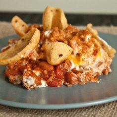 This is the Frito Pie I knew about before we moved to Oregon. I was shocked when I was first served it here--it was just heated canned chili poured over Fritos in a bowl, topped with chopped onions. This recipe is the REAL Frito pie!