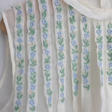 Embroidered tucks