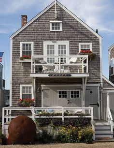This two-story cottage, dubbed Essex, is surrounded by water. The double boathouse doors are part of the original architecture.