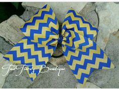 Royal blue and yellow glitter Chevron cheer bow for softball and cheer teams! Team discounts always given!  Cheer and Sports team bows by Two Tiara's Bowtique on Etsy or Facebook!  Check out this item in my Etsy shop https://www.etsy.com/listing/219891711/chevron-cheer-bow-royal-blue-and-yellow