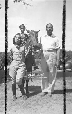 Portrait of an unidentified family (friends and/or family members of future newspaper publisher John H. Sengstacke) as they pose with a horse (the youngest one astride the horse), Idlewild, Michigan, September 1938. Idlewild, known as 'the Black Eden,' was a resort community that catered to African Americans, who were excluded from other resorts prior to the passage of the Civil RIghts Act of 1964.