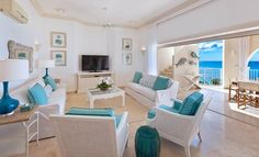 A serene Penthouse in Barbados overlooks the clear blue waters of Mullins Bay.